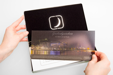 The Photonight voucher in the gift box